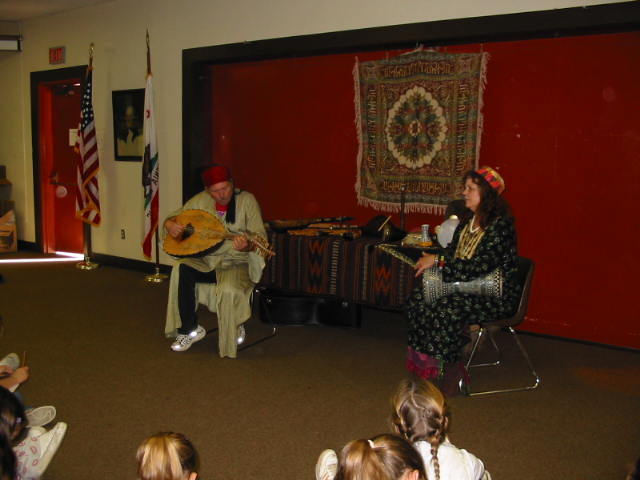 Deb on drum and Ern playing Egyptian lute called, 'OUD' or 'UD'